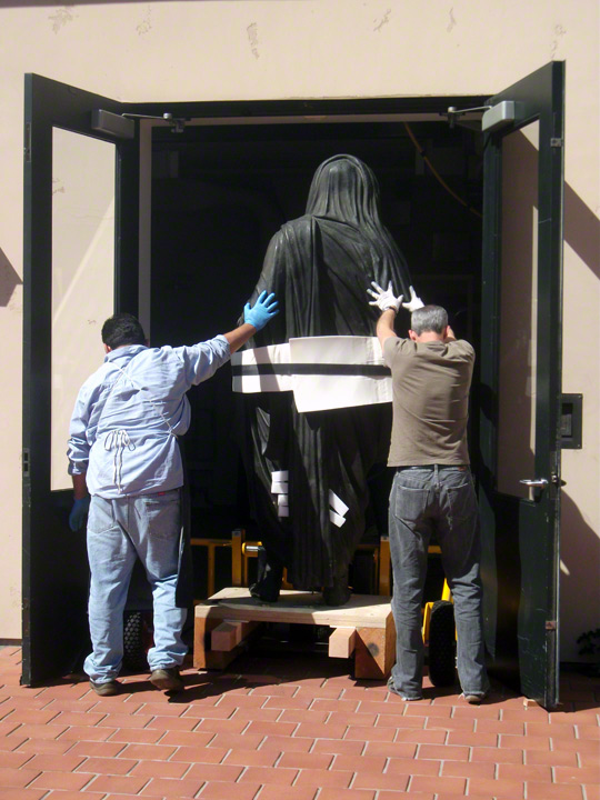 Wheeling the Statue of Tiberius into the conservation studios at the Getty Villa