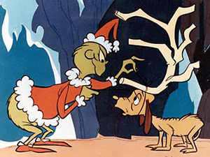 The Grinch converts his long-suffering dog Max into a reindeer in How the Grinch Stole Christmas!