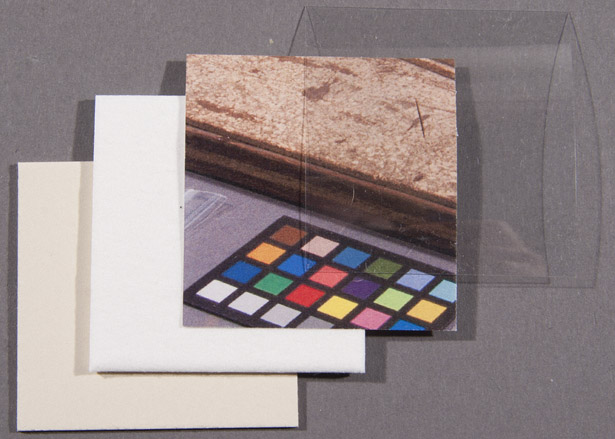 Facsimile of cardboard, blotting paper, colored paper, and domed Mylar used in the conservation of Mapplethorpe's box