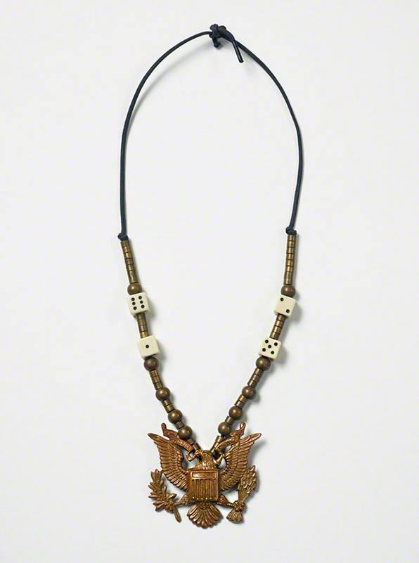 Necklace with dice, brass eagle, and beads on a cotton cord / Robert Mapplethorpe