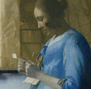 Detail of woman&#039;s face and letter in Woman in Blue Reading a Letter / Vermeer