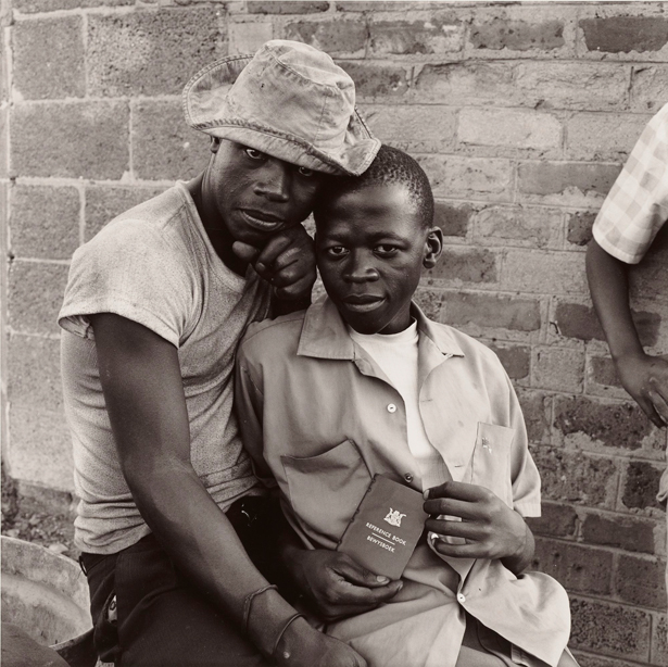 Young Men with dompas, White City, Jabavu, Soweto / David Goldblatt
