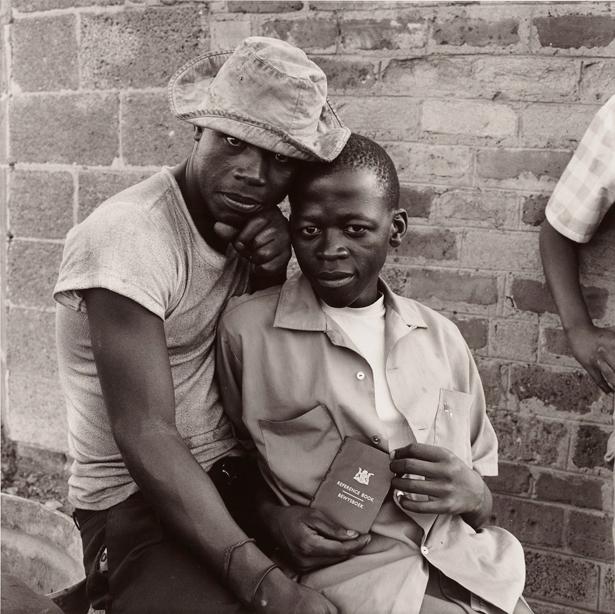 Young Men with dompas, White City, Jabavu, Soweto / David Goldblatt