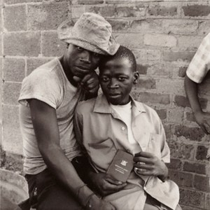 David Goldblatt (South African, born 1930), Young Men with dompas, White City, Jabavu, Soweto, November 1972, Gelatin silver print, 22.9 x 22.9 cm (9 x 9 in.), The J. Paul Getty Museum, Los Angeles, Purchased with funds provided by the Photographs Council, © David Goldblatt