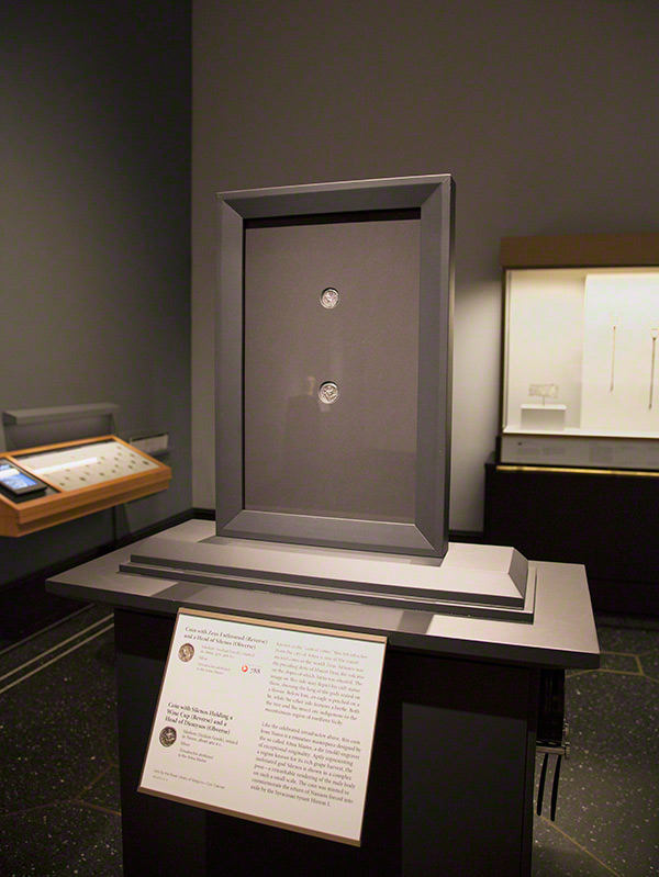 Double-sided coin frame in the Sicily exhibition at the Getty Villa