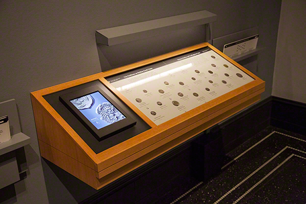 Case of coins in the Sicily exhibition at the Getty Villa, showing iPad for close-up viewing