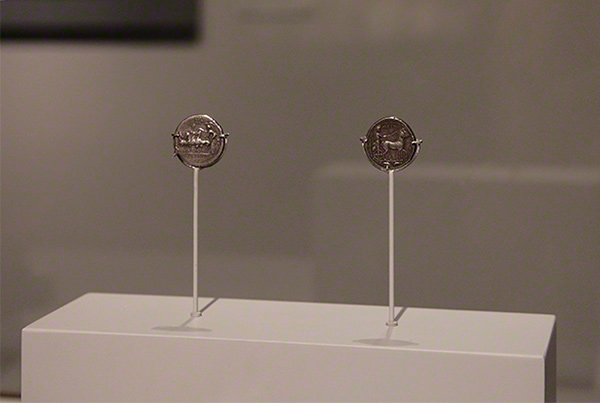Coins mounted on small stands for close viewing in the Sicily exhibition at the Getty Villa