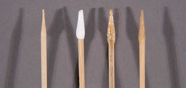 Wooden stick, wet and dried Lascaux adhesive, used tool