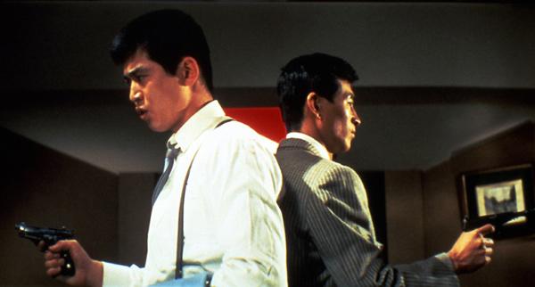 Still from Tokyo Drifter / back-to-back hitmen with guns