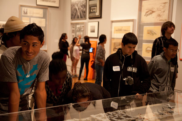 Students recognize models and blueprints of familiar architectural landmarks at the Overdrive exhibition