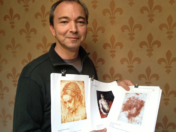 Julian Brooks in Florence with reproductions of Andrea del Sarto's Renaissance drawings