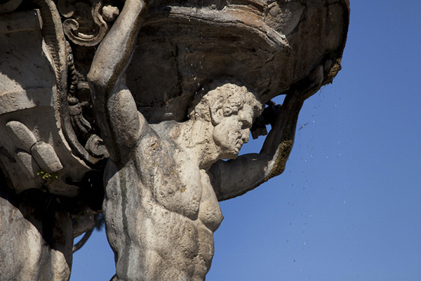 Detail of a stone fountain in Rome, Italy, showing damage caused by weathering