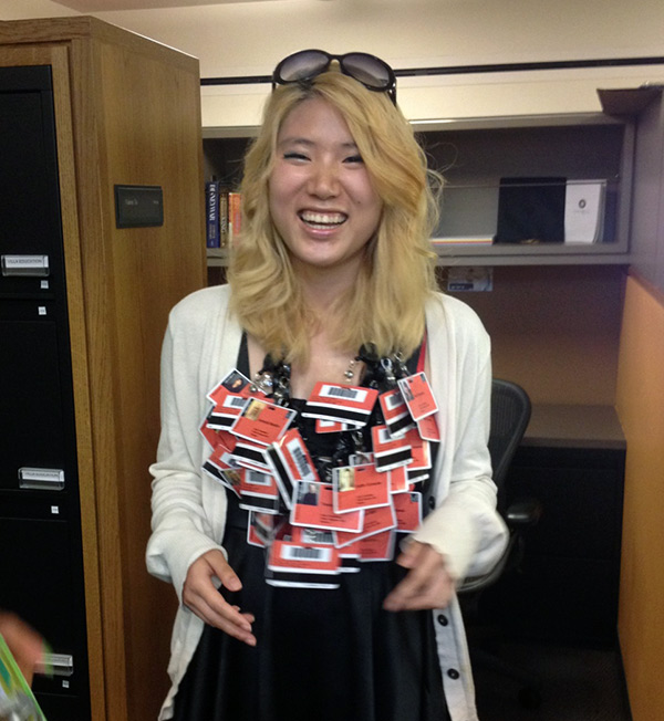 Valerie Tu with red name badges for the cast and crew of Prometheus Bound