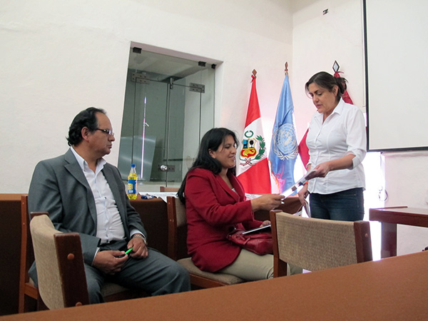 Claudia Cancino with representatives from the Peruvian Ministry of Culture, summer 2013