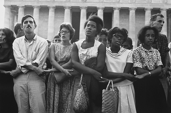 Group of black and white marchers holding hands at the March on Washington