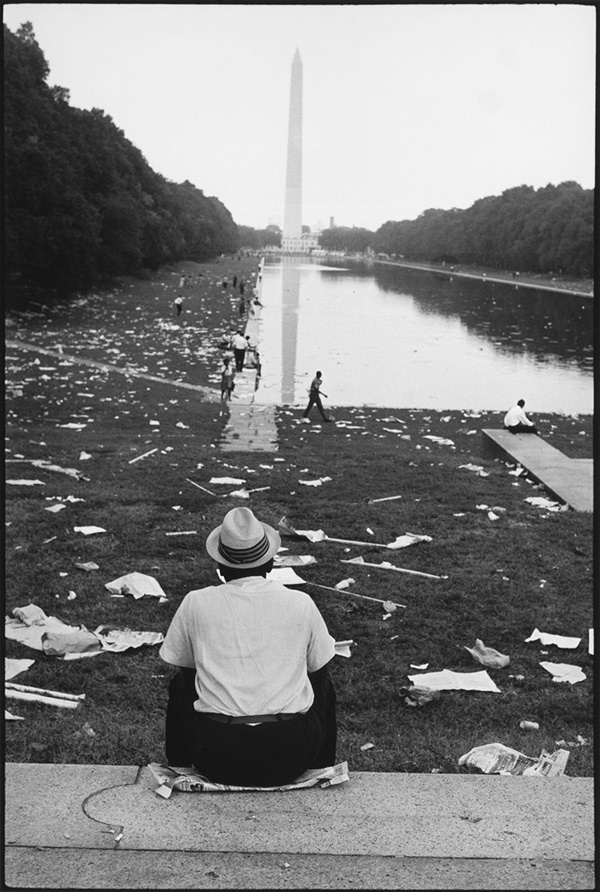 African American man in hat viewing the Washington Monument after the March on Washington, 1963
