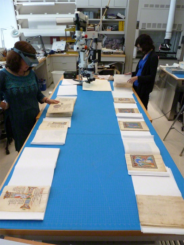 Nancy Turner and Kristen Collins with the St. Albans Psalter in the conservation lab