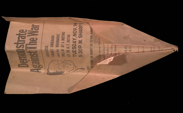 Paper airplane made from a flier titled Demonstrate Against the War, 1967