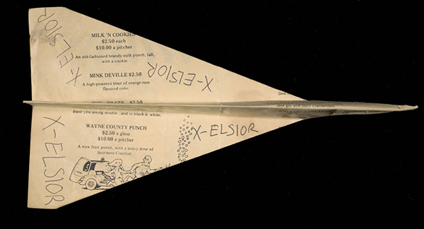 Paper airplane made from a menu inscribed X-celsior from Max's Kansas City, about 1978