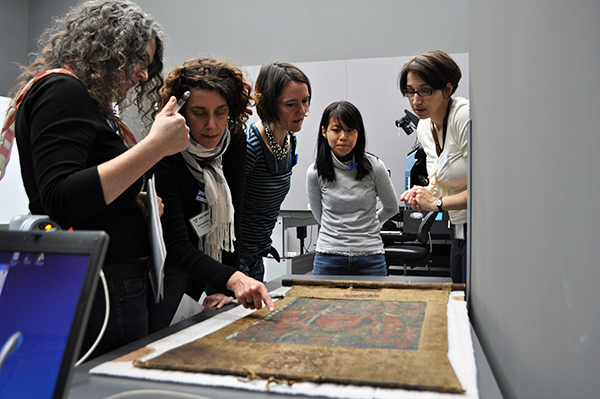 Aniko Bezur works with conservators at the Yale Center of Conservation and Preservation