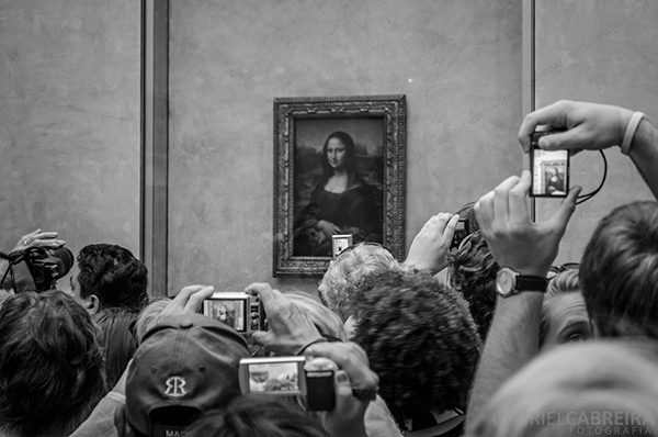 Crowds throng the Mona Lisa at the Louvre Museum, Paris