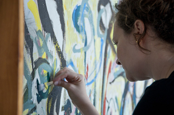 Laura Rivers works on Jackson Pollock's Mural in the Getty Museum's paintings conservation studio