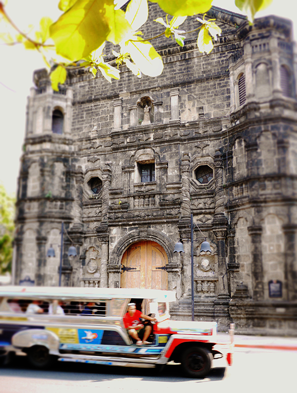 Façade of the church of Malate with a passing jeepney, a typical mode of local transport, in Intramuros, Manila. Photo: Marco Musillo