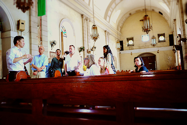 Interior of Malate Church with tour led by Architect Michael (Mico) Manolo, shown at left. Photo: Marco Musillo