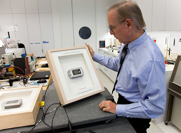 Getty Conservation Institute scientist Jim Druzik with a high-tech frame