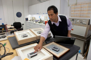Getty Conservation Institute scientist Vincent Beltran working on high-tech frames