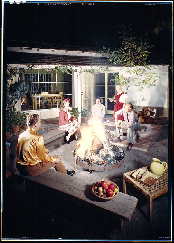 Roasting hot dogs on the patio fire pit, Cliff May residence, Riviera Ranch, Los Angeles, c.1943