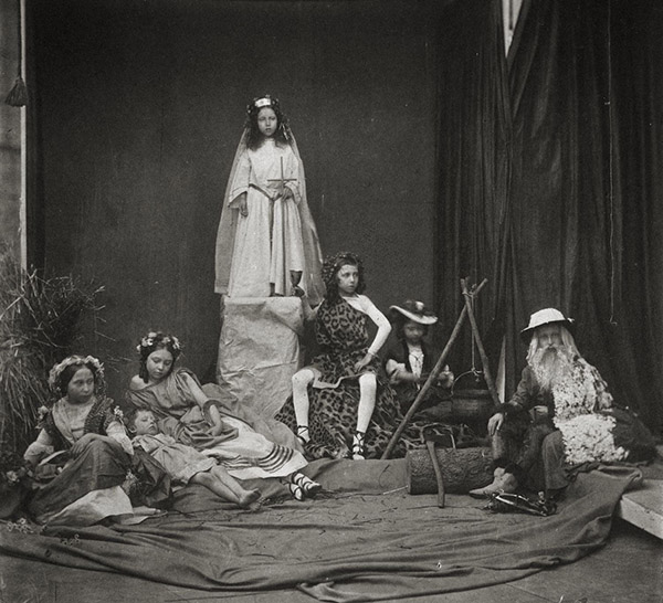 "Princess Alice as ""Spring,"" Prince Arthur and the Princess Royal as ""Summer,"" Princess Helena as ""The Spirit Empress,"" Prince Alfred as ""Autumn,"" Princess Louise and the Prince of Wales as ""Winter"" in the fifth and concluding Tableau of the Seasons, 1854, Roger Fenton. Royal Collection Trust / Her Majesty Queen Elizabeth II 2014"