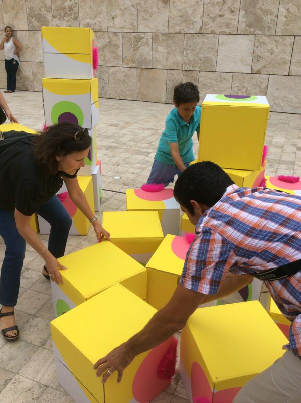 A family builds Fuzzy Grids II at the Getty Center