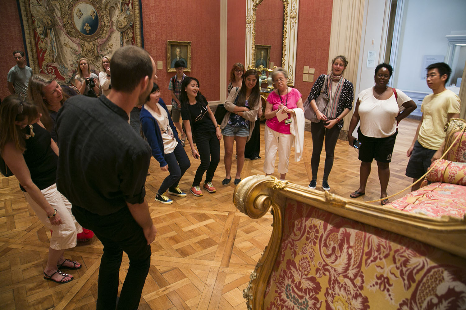 """Are we allowed to move like this?"" As participants explore what the Pink Bed might be asking of them, this frequent question reflects the tour's playful subversion of behavioral norms."