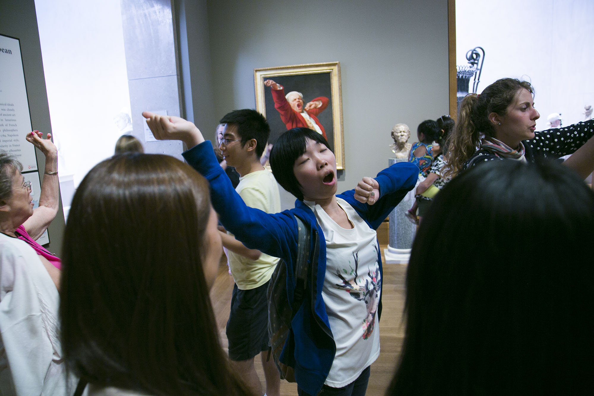 Move! participants work together to imitate details in Joseph Ducreux's Self-Portrait, Yawning.