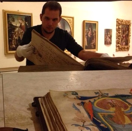 Examining manuscripts illuminated by Pacino di Bonaguida on a recent trip to Italy.
