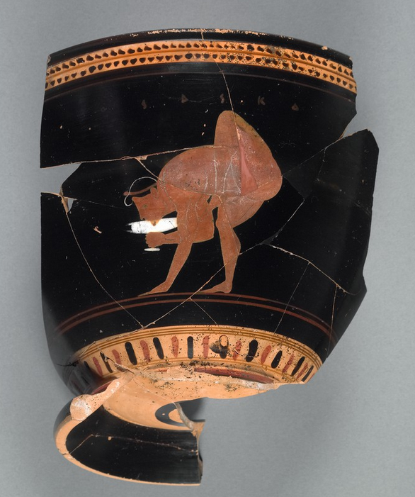 Fragmentary Mug with a Youth Drinking from a Wine Cup, 510–500 B.C., attributed to near the Theseus Painter, vase-painter; and to the Heron Class, potter. Greek, made in Athens. Terracotta, 6 1/4 in. high. The J. Paul Getty Museum, 76.AE.127. Gift of Lynda and Max Palevsky