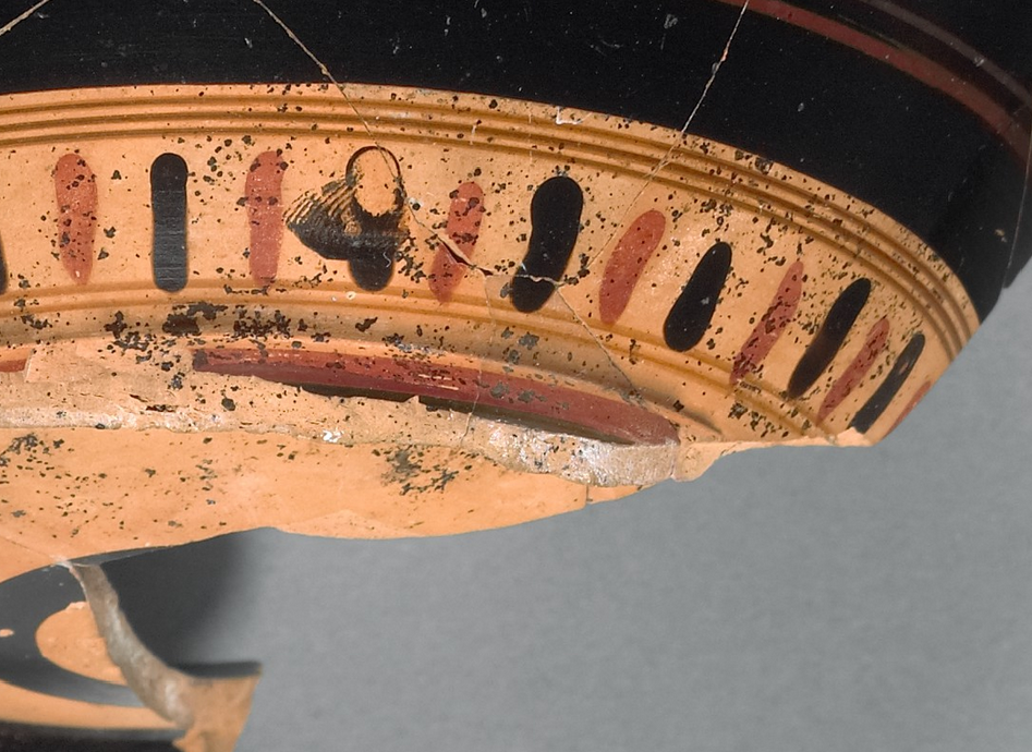 Fragmentary Mug with a Youth Drinking from a Wine Cup (detail), 510–500 B.C., attributed to near the Theseus Painter, vase-painter; and to the Heron Class, potter. Greek, made in Athens. Terracotta, 6 1/4 in. high. The J. Paul Getty Museum, 76.AE.127. Gift of Lynda and Max Palevsky