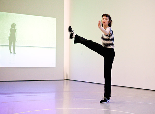 Pat Catterson performing Yvonne Rainer's Trio A at MoMA, 2009