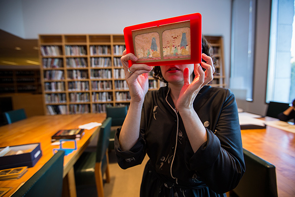 Mazie Harris viewing a stereograph in the Getty Museum's Department of Photographs