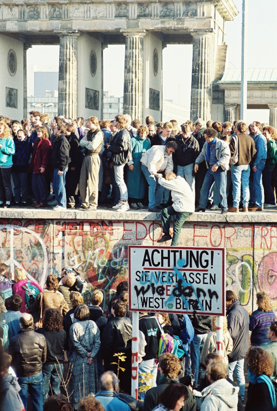 Celebration during the fall of the Berlin Wall / Sue Ream