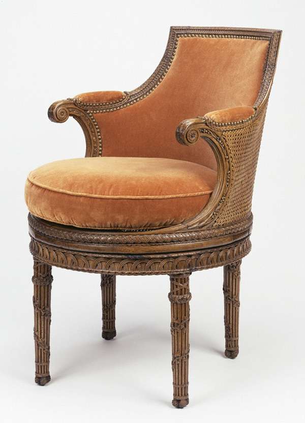 Chair with naturalistic carvings and velvet upholstery