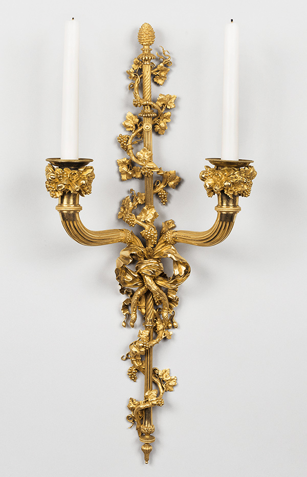 Gilded wood wall light holding two candles