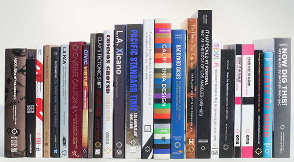 Shelf of exhibition catalogues from Pacific Standard Time: Art in L.A., 1945-1980