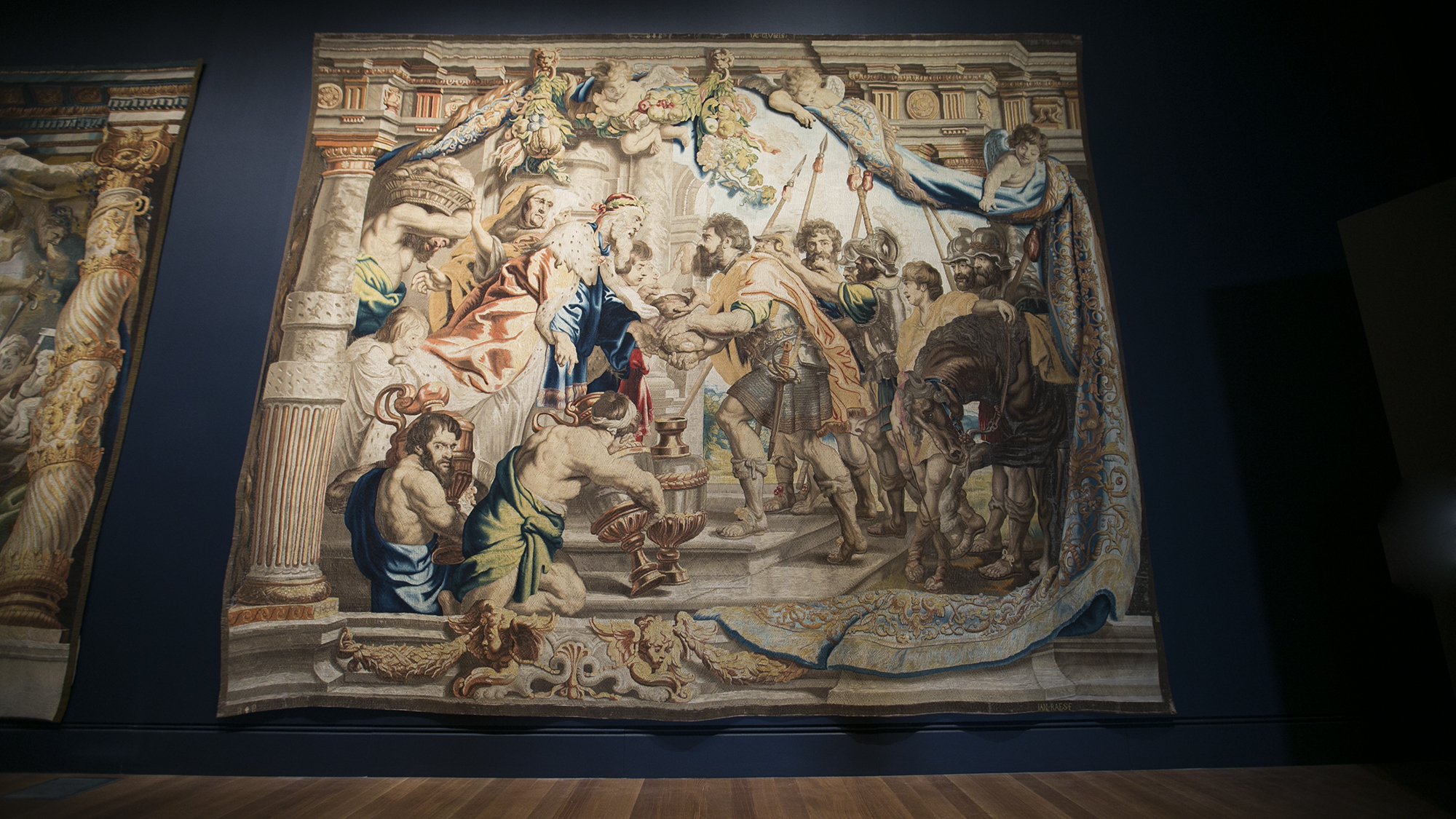 After it's hoisted, preps removes the hooks, ropes, and secures the tapestry to the wall. Beautiful!