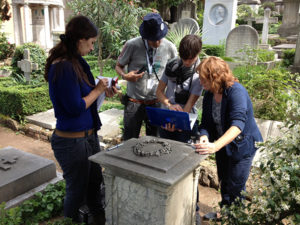 Conservators learn how to perform analysis of biological growth in a cemetery in Rome during the International Course on Stone Conservation. Photo: Scott Warren for the GCI