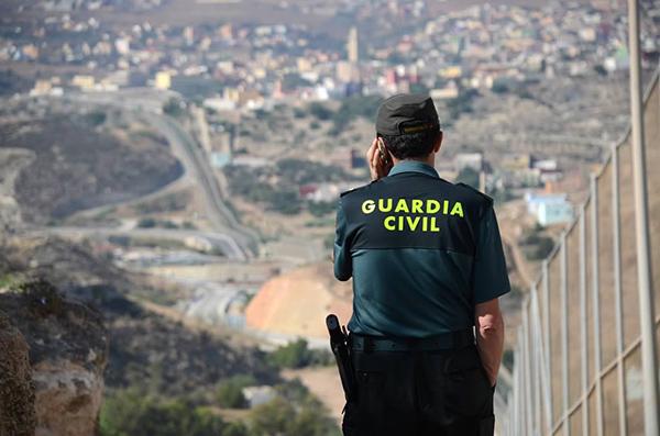 Guard at the Melilla border fence