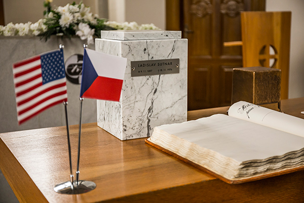 American and Czech flags with the ashes of Ladislav Sutnar