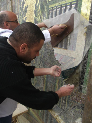 Participants in the 2011–13 MOSAIKON training course organized by CCA conserve damaged mosaics on the façade of the Umayyad Mosque in Damascus, Syria. Photo © DGAM Syria
