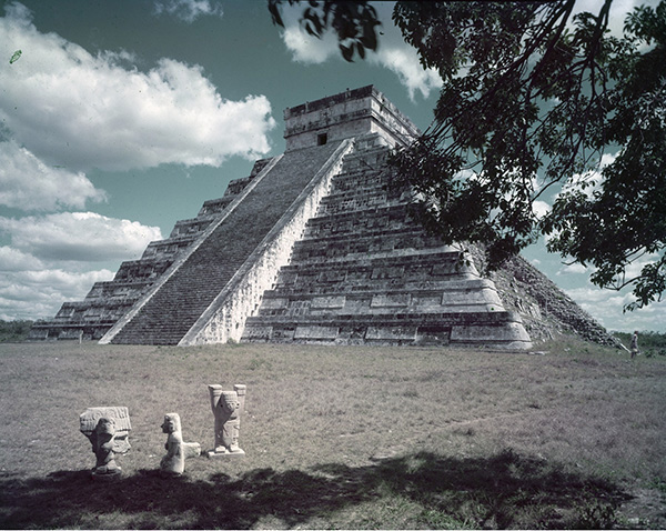 Fig. 2. A view of Chichen Itza's Castillo framed by Shulman's characteristic foliage. Julius Shulman photography archive. The Getty Research Institute, 2004.R.10